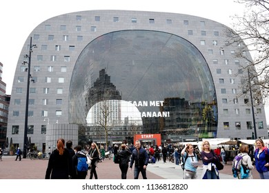People walk outside  of Markthal, a modern dutch marketplace Rotterdam, Netherland on Apr. 14, 2018