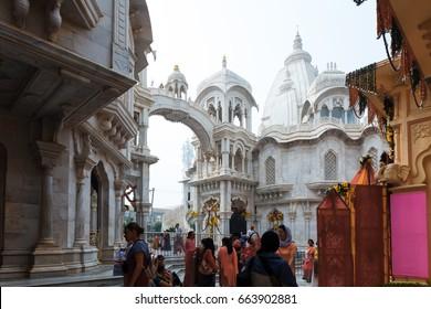 people walk parikrama Vrindavan street temple.India, Vrindavan, November 2016