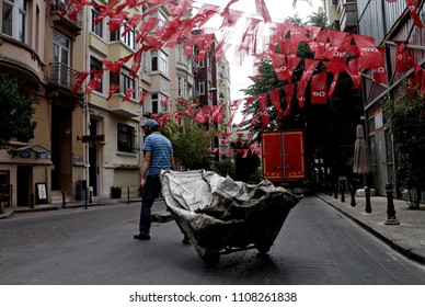 People walk past of flags of Republican People's Party (CHP) election campaign in Istanbul June 2, 2015