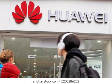People walk past of a Huawei brand store in Kiev, Ukraine, on 20 October 2018