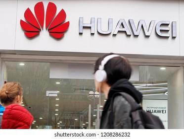 People walk past of a Huawei brand store in Kiev, Ukraine, on 20 October 2018