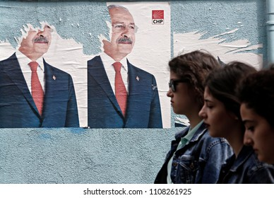 People walk past of posters of Republican People's Party (CHP) election campaign in Istanbul June 2, 2015