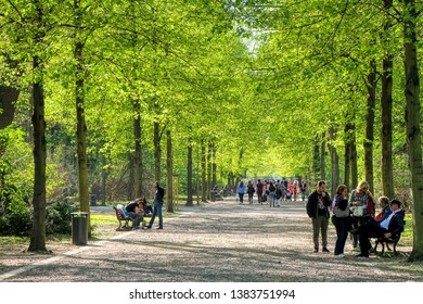 People walk in the Tiergarten Park in Berlin, Germany - 20/04/2019