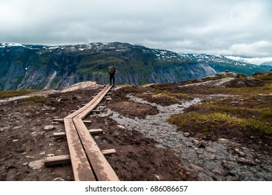People walk the trail to Troll's Tongue (Trolltunga) rock in Hordaland county, Norway. The 22km trail to Trolltunga is among most visited in Norway.
