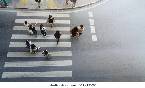 people walk and watch on crosswalk street at the top view of city street. (aerial view)