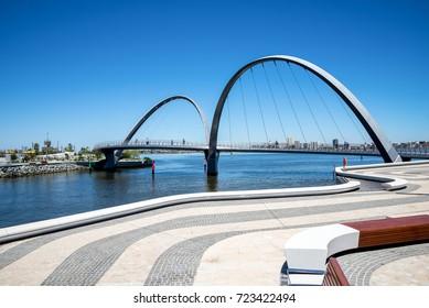 People walking across Elizabeth Quay Bridge in Perth City, Western Australia