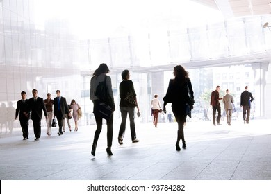 People walking against a light background.