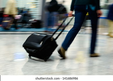 People walking at airport (motion blur)
