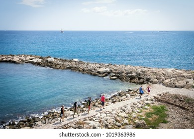 People walking along coast at Côte d'azur
