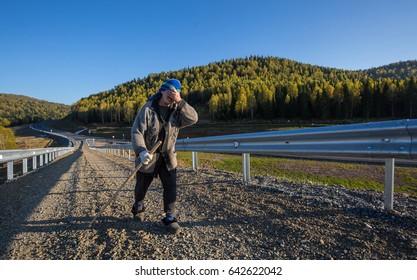 People walking along the road. Siberia, Russia