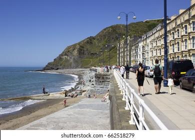 People walking along the sea in Aberystwyth. Resort town in Wale