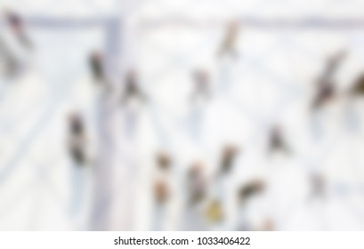 People walking. Background with an intentional blur effect applied.