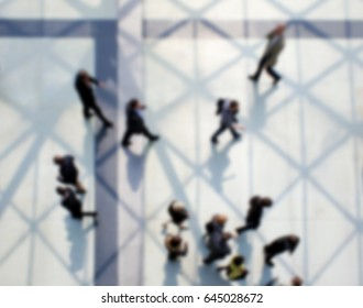 People walking. Background with an intentional blur effect applied. Panoramic view.