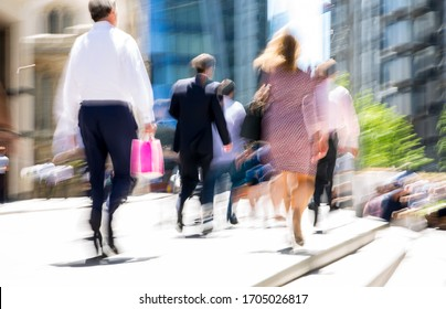 People walking in the City of London. Blurred image of the road with people at sunny day. London, UK