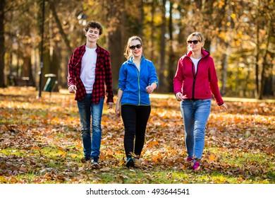 People walking in city park