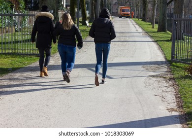 people walking in city park at february sunny winter afternoon in a historical city of south germany