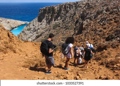 People walking down the cliff to Seitan Limania beach, Crete, Greece