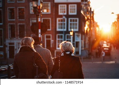 People walking down the streets of Amsterdam in the middle of the winter
