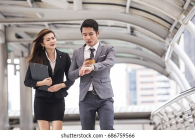 People walking fast because late for meeting for business project, Woman follow businessman for work.