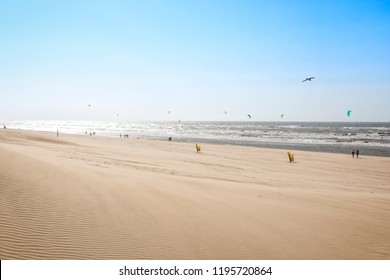 People walking and kite surfing at the North Sea Beach of Noordwijk aan Zee, The Netherlands