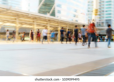 People walking in motion blur in the city