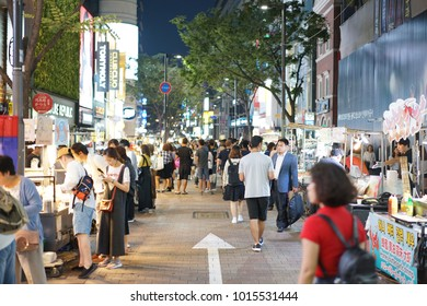 People are walking at Myeong-dong, night market that is one of the key shopping and streetfood districts in Seoul, Korea on 17 September 2017