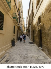People Walking Narrow Maltese Street, Summer 2018 Street photography