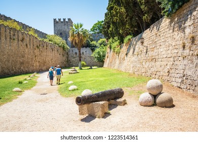 People walking next to Grand master palace in old town of Rhodes (Rhodes, Greece)