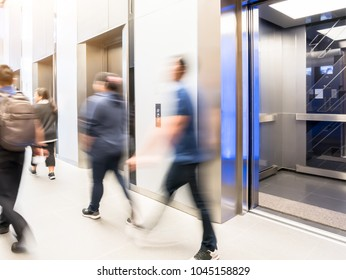 People are walking in office past elevators, Modern steel elevator cabins in a business lobby or Hotel, Store, interior, office,perspective wide angle.