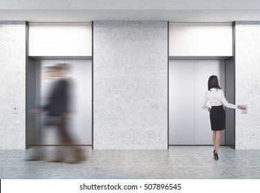 People are walking in office. Two closed elevators with buttons in corridor with concrete walls. Concept of office center day. 3d rendering. Mock up.