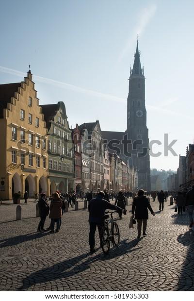 people walking in the old town of Landshut, Bavaria