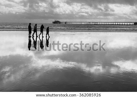People Walking On A Beach Black And White Photography