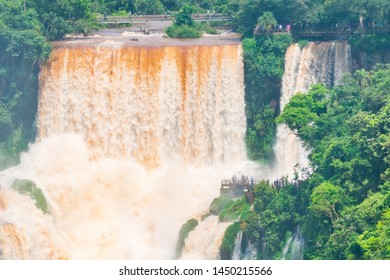 People walking on the catwalks at Iguazu Falls at the border of Brazil and Argentina