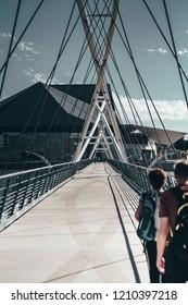 People walking on city bridge