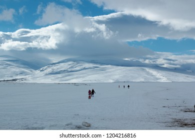 people are walking on the frozen Cildir Lake Ardahan, Turkey