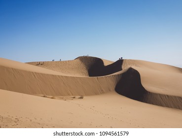 People walking on Imperial Sand dunes, Arizona USA