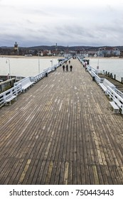 People walking on a pier (Molo) in Sopot city, Poland. Built in 1827 with 511m long it is the longest wooden pier in Europe (non recognizable people)