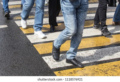 people walking on the road at a pedestrian crossing