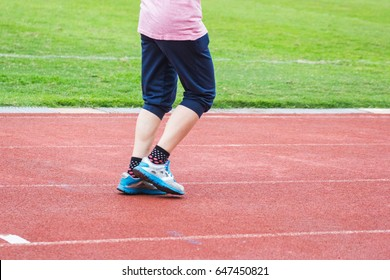People  Walking on a running track - Use For fitness or competition.