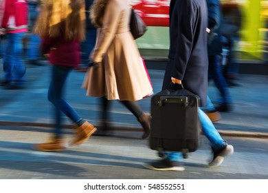 people walking on a shopping street in motion blur