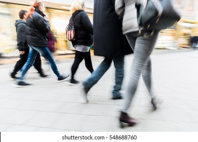people walking on a shopping street with camera made motion blur