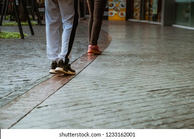 People walking on the sidewalk.