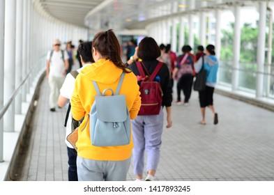 People walking on the skywalk. in citygates Hong Kong. 5 November 2018