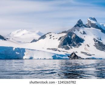 People walking on slope of Spigot Peak on Arctowski peninsula, Antarctic Peninsula, Antarctica