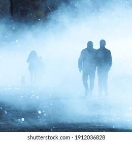 people walking on the street with fog in Bilbao city, spain
