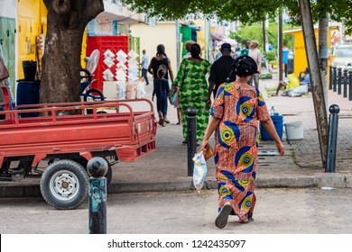 People walking on the streets of Brazzaville, Congo Republic, West Africa. Traditional clothes outfit for women walking on the street.