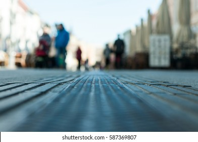 People walking on the urban street in the city blurred low point of view