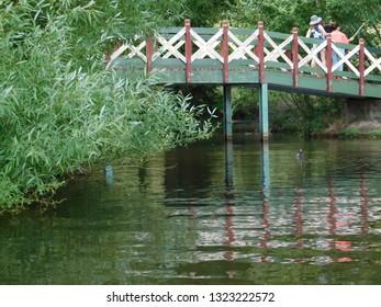 People Walking over a Bridge at Lake Daylesford