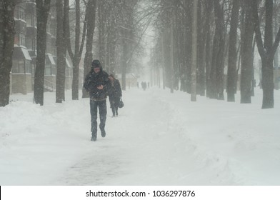 people walking in the snow and snowstorms Kharkiv, Ukraine March 1, 2018