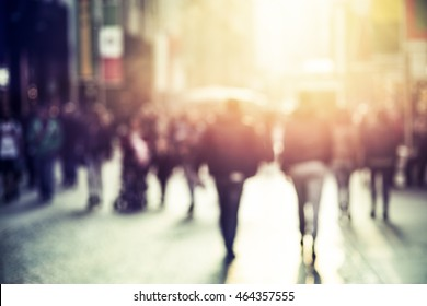 people walking in the street, abstract,  blurry